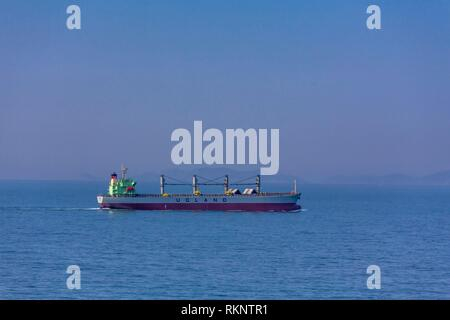 A cargo ship in the South China Sea near Japan. - Stock Photo