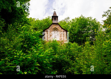 Chapelle Sainte Foy in the picturesque village of Conques in France. The village is on the pilgrim route of the Camino de Santiago Compostella. - Stock Photo