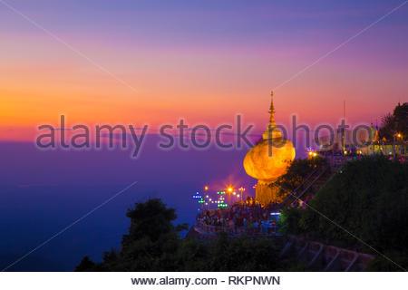 The Golden Rock Pagoda of Myanmar Kyaiktiyo Pagoda (The Golden Rock Pagoda), one of the famous landmarks of Myanmar, glows golden at sunset. - Stock Photo
