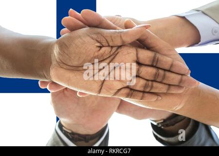 Finland flag, intergration of a multicultural group of young people. - Stock Photo