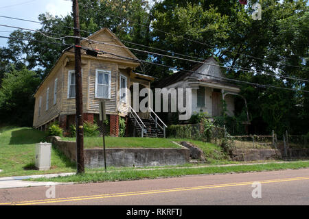 Old abandoned buildings in downtown Natchez, Mississippi, United States of America. Economic crisis and depression with empty wooden houses and homes - Stock Photo