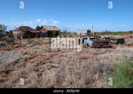 Abandoned buildings in Cuervo, ghost town of New Mexico, United States of America, along the highway Interstate I-40. View of a small American village - Stock Photo