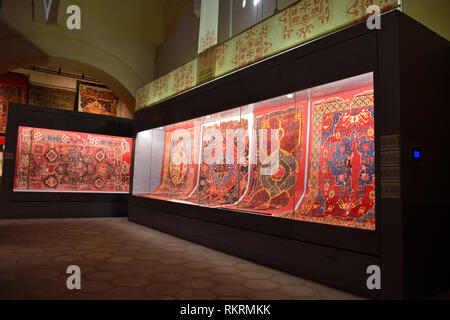 Istanbul, Turkey - April 23, 2017. Interior view of Carpet Museum in Istanbul, with ancient carpets on display. - Stock Photo