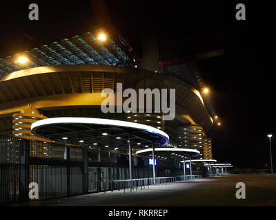 San Siro Stadium house of Inter Milan and Milan AC Football Soccer clubs in Milan Italy by Night. It is also known as Giuseppe Meazza Stadium. Stock Photo