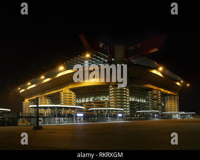 San Siro Stadium house of Inter Milan and Milan AC Football Soccer clubs in Milan Italy by Night. It is also known as Giuseppe Meazza Stadium. - Stock Photo