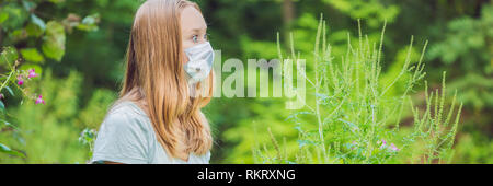 Young woman in a medical mask because of an allergy to ragweed BANNER, long format - Stock Photo