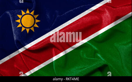 Realistic flag of Namibia on the wavy surface of fabric - Stock Photo
