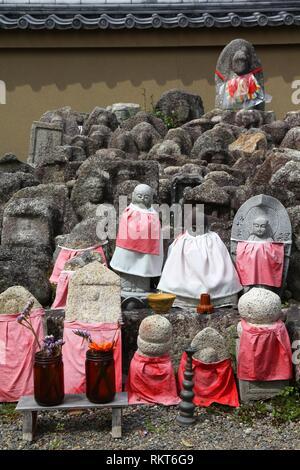 Kyoto, Japan - small jizo statues at famous Daitokuji (Daitoku-ji) Temple. Buddhist zen temple of Rinzai school. Jizo, also known as Ksitigarbha are b - Stock Photo