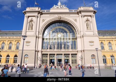 BUDAPEST, HUNGARY - JUNE 20, 2014: People visit Keleti Station in Budapest. Keleti is the Eastern railway station, was opened in 1884 and is among lar - Stock Photo