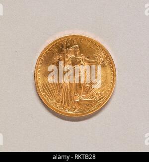 United States Twenty Dollar Coin - 1907 - Augustus Saint-Gaudens American, born Ireland, 1848–1907 Modified by Charles E. Barber American, 1841–1917 - Stock Photo