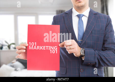 Male salesperson advertising onehundred and one marketing on red paper as must-know concept - Stock Photo