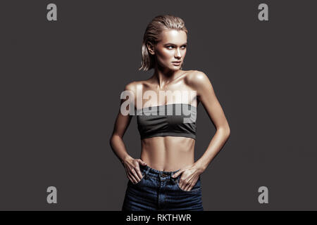 Famous young promising model working in photo studio - Stock Photo