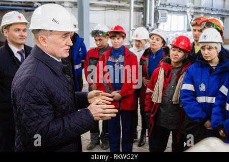 Chelyabinsk, Russia. 12th Feb, 2019. CHELYABINSK, RUSSIA - FEBRUARY 12, 2019: Pavel Izbrekht, general director, chairman of the Management Board at Chelyabinsk Zinc Plant, and Chelyabinsk Region Governor Boris Dubrovsky (L-R) talk to Chelyabinsk Zinc Plant workers. Nail Fattakhov/TASS Credit: ITAR-TASS News Agency/Alamy Live News - Stock Photo