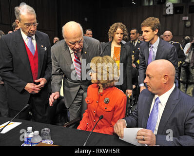 January 30, 2012 - Washington, District of Columbia, U.S. - United States Senator Chuck Grassley (Republican of Iowa), left, the Ranking Member, and Chairman Patrick Leahy (Democrat of Vermont), left center, checks former U.S. Representative Gabrielle Giffords (Democrat of Arizona), lower center, at the witness table as she prepares to read a statement before U. S. Senate Committee on the Judiciary hearing entitled ?What Should America Do About Gun Violence?? on Capitol Hill in Washington, DC on Wednesday, January 30, 2013. Her husband, Captain Mark Kelly, United States Navy (Retired), repre - Stock Photo