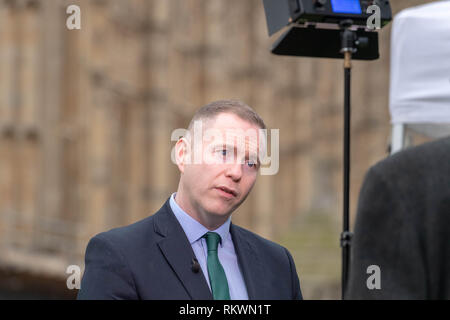London 12th   February 2019, Chris Hazzard,  Sinn Fein MP for South Down being interviewed over Brexit on College Green, London Credit Ian Davidson/Alamy Live News - Stock Photo