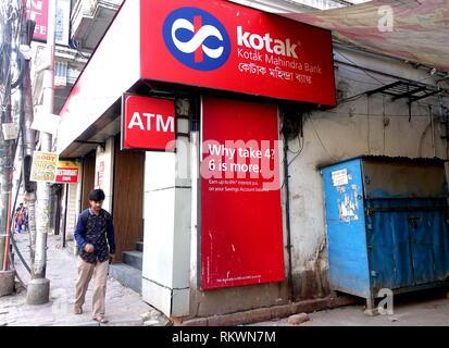 February 12, 2019 - Kolkata, WEST BENGAL, India - A man seen walking in front of the Kotak Mahindra Bank..ATM Operation for Kotak Mahindra Bank has started in some prominent location of Kolkata. (Credit Image: © Avishek Das/SOPA Images via ZUMA Wire) - Stock Photo
