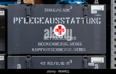 Raisdorf, Germany. 04th Feb, 2019. DRK Logistikzentrum stores a transport box with the inscription 'Care equipment, white sheet, white blanket cover, white pillowcase' on a shelf. Credit: Markus Scholz/dpa/Alamy Live News - Stock Photo