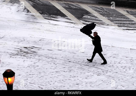 New York, USA. 12th Feb, 2019. A pedestrian walks in the snow in New York, the United States, on Feb. 12, 2019. Credit: Li Muzi/Xinhua/Alamy Live News - Stock Photo