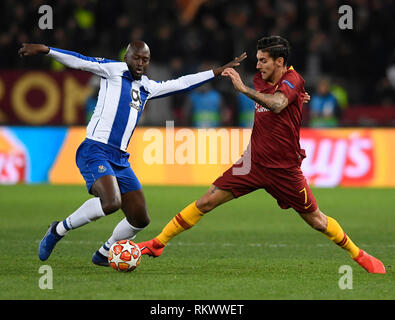 Rome, Italy. 12th Feb, 2019. Roma's Lorenzo Pellegrini (R) vies with Porto's Danilo during the UEFA Champions League round of 16 first leg soccer match between Roma and Porto in Rome, Italy, Feb. 12, 2019. Roma won 2-1. Credit: Alberto Lingria/Xinhua/Alamy Live News - Stock Photo
