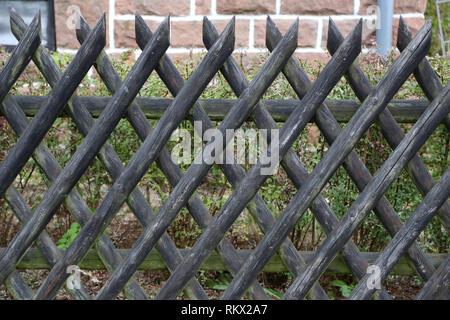 Wattle fence in Garden. Garden wooden fence. - Stock Photo