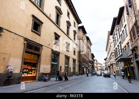 Firenze, Italy - August 31, 2018: Outside exterior of stores buildings in Tuscany on Via dei Cerretani alley street in dark morning wide angle view - Stock Photo