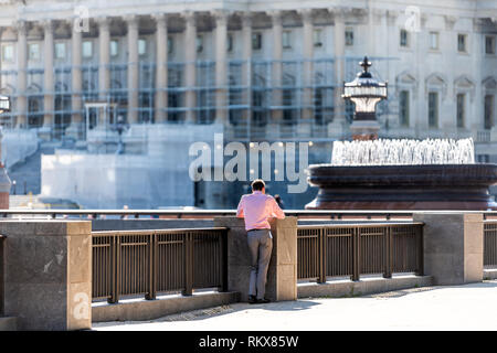 Washington DC, USA - October 12, 2018: People business worker standing on Capitol Hill by building in district of columbria during sunny autumn day on - Stock Photo