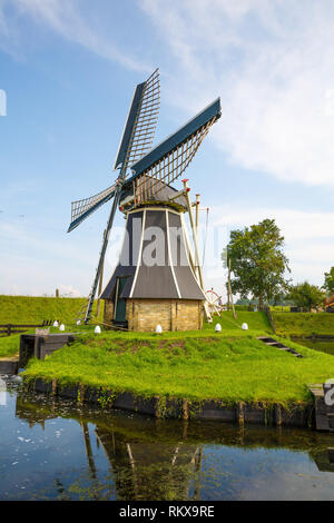 The windmill in the traditional old fisherman village open-air museum of Zuiderzee (Zuiderzeemuseum), Enkhuizen, Netherlands. - Stock Photo