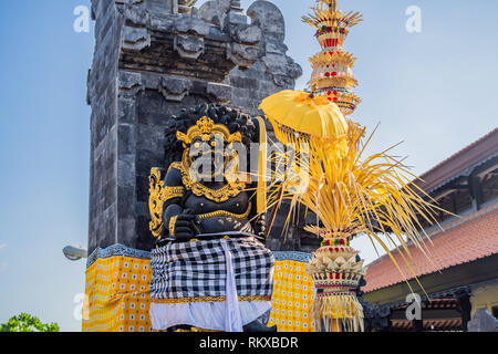 Balinese traditional gate at the entrance to the temple of Tanah Lot - Stock Photo