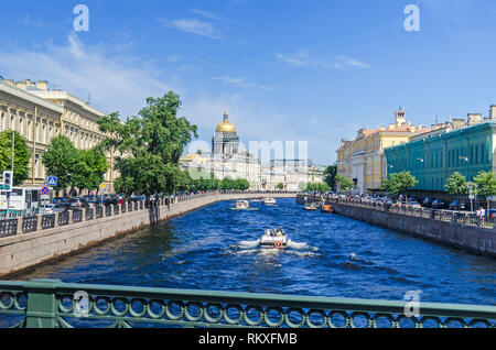 Saint Petersburg, Russia -  June 27, 2018: Embankment river Moyka, tourist boats and the Saint Isaac's Cathedral  or Isaakievskiy Sobor - Stock Photo