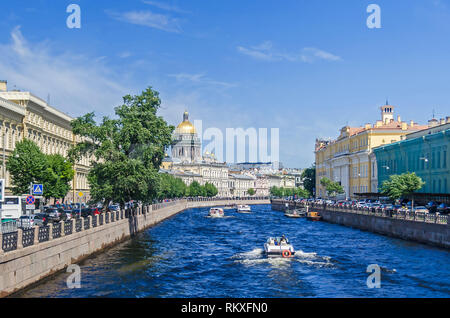 Saint Petersburg, Russia -  June 27, 2018: Embankment river Moyka, tourist boats and the Saint Isaac's Cathedral - Stock Photo