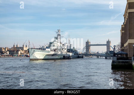 HMS Belfast is a Town-class light cruiser that was built for the Royal Navy.  She is moored on the River Thames, London, England as a museum ship. - Stock Photo