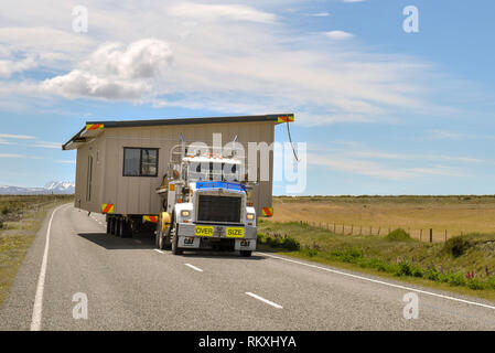 House being moved on a lorry, road from Lake Pukaki, South Island, New Zealand - Stock Photo