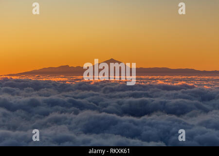 View of the Teide volcano in Tenerife, the highest mouintain in Europe at sunset from the air - Stock Photo