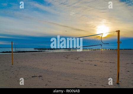 Volleyball net on the lonely beach on the sunny afternoon in Brooklyn. - Stock Photo