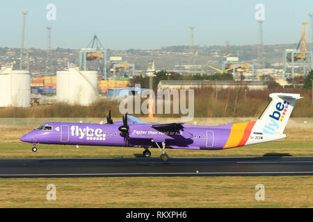 Flybe Aircraft arrive and depart from George Best Belfast City Airport in Belfast, Northern Ireland. - Stock Photo