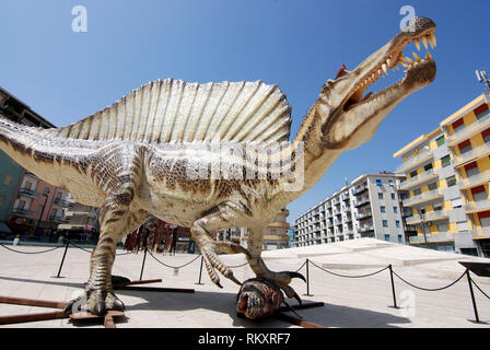 dinosaurs walking around the city 1:1 scale reproduction dinosaur spinosaurus aegyptiacus exposed in cosenza city calabria italy 2018 - Stock Photo