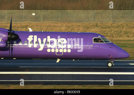 Bombardier Dash 8 Q400 Flybe Aircraft arrive and depart from George Best Belfast City Airport in Belfast, Northern Ireland. - Stock Photo