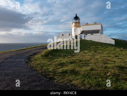 Stoerhead Lighthouse on a sunny day with clouds overhead, Lairg, Sutherland, Scotland - Stock Photo
