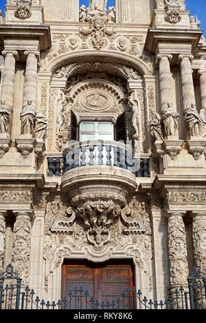 Baroque façade of San Telmo Palace. Nowadays, this 17th century building is the site of the Government of Andalucia. It used to belong to the Holy - Stock Photo
