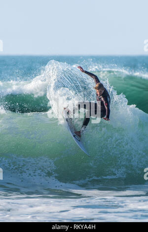 Spectacular surf action at Fistral Beach in Newquay in Cornwall. - Stock Photo