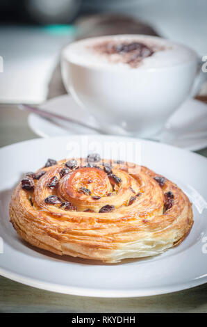 coffee and pain aux raisin - Stock Photo