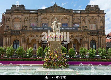 William Etty statue decorated with flowers for the Bloom Festival Exhibition Square. - Stock Photo
