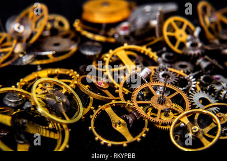 Vintage cogs gears wheels collection set on black background - Stock Photo