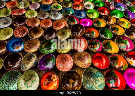 Colorful Vietnamese lacquer coconut shell bowls, Sunday market at Ba Ha, northern Vietnam. Every Sunday ethnic minorities come from surrounding - Stock Photo
