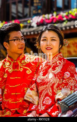A couple wearing traditional costumes having wedding photos taken in the ancient town of Shuhe, 4 km. (2. 5 miles) from Lijiang, Yunnan Province, - Stock Photo