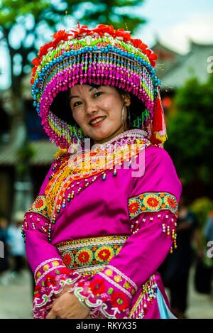 A woman of the Miao ethnic minority wearing traditional clothing, in the Old Town (Dayan) of Lijiang, Yunnan Province, China. The Old Town is a - Stock Photo