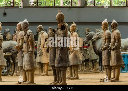 The Terracotta Army was found extensively damaged when discovered in 1974. The warriors have been painstakingly reassembled. Mausoleum of the First - Stock Photo