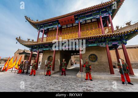 A mock army like one that would have once occupied the fort. Jiayuguan Fort is the western end of the Great Wall built in the Ming Dynasty (1368 - - Stock Photo