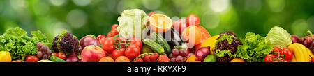 Collage natural vegetables and fruits on dark green blurred background - Stock Photo