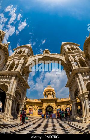 Sri Krishna-Balaram Mandir (Hare Krishna Hindu Temple) during Holi festival, Vrindavan, near Mathura, Uttar Pradesh, India. - Stock Photo